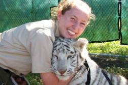 Tiger snuggles with Mr. King.